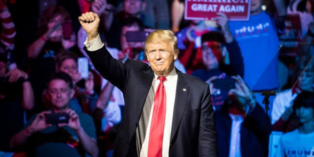 Republican presidential candidate Donald Trump waves to the crowd during a campaign rally, Thursday, Oct. 13, 2016, in Cincin
