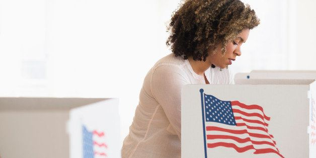 Young woman preparing voting booth
