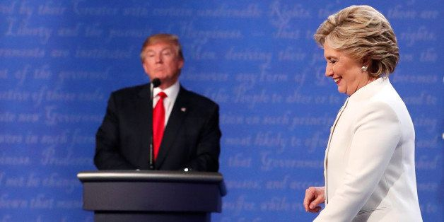 Democratic U.S. presidential nominee Hillary Clinton walks off the debate stage as Republican U.S. presidential nominee Donal