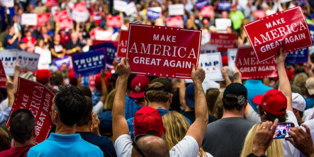 AKRON, OH - AUGUST 22: Supporters hold up signs during a campaign rally of Republican presidential nominee Donald Trump at th