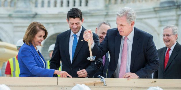 UNITED STATES - SEPTEMBER 21: House Majority Leader Kevin McCarthy, R-Calif., pulls the bent nail of Sen. Charles Schumer, D-