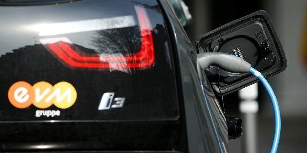 FILE PHOTO - A BMW i-3 electrical car is refueled at a power station for e-cars in the city centre of the western German city