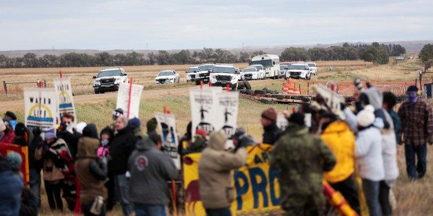Dakota Access Pipeline protesters square off against police between near Standing Rock Reservation and the pipeline route out