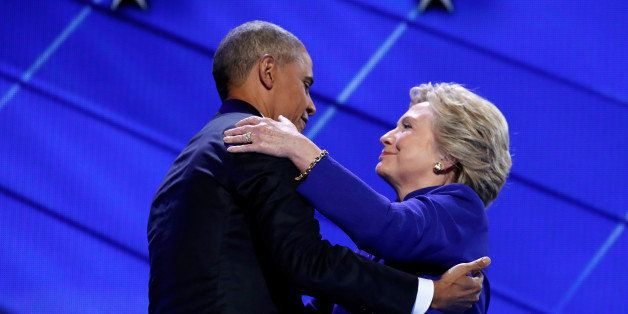 Democratic presidential nominee Hillary Clinton greets U.S. President Barack Obama as she arrives onstage at the end of his s