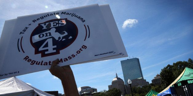 BOSTON - SEPTEMBER 17: A sign in support of Question 4 is raised in the air during the Boston Freedom Rally on Boston Common