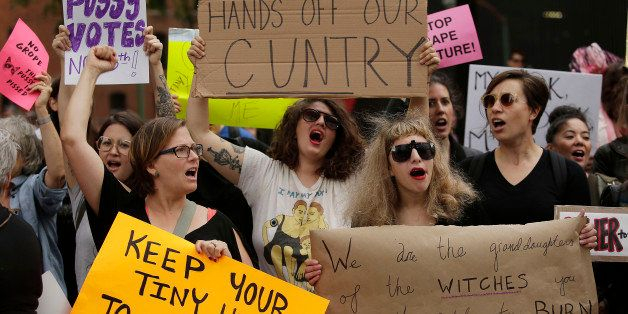 Women take part in a protest against Republican presidential candidate Donald Trump outside the Trump International Hotel and
