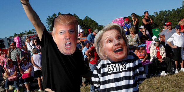 Craig Wendel dresses as Republican U.S. presidential nominee Donald Trump and his wife Jill Wendel wears a Hillary Clinton ma