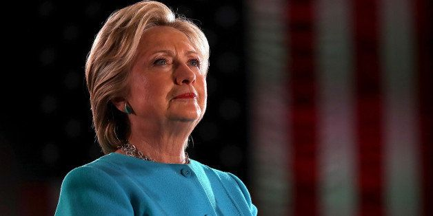 MANCHESTER, NH - NOVEMBER 06: Democratic presidential nominee former Secretary of State Hillary Clinton looks on during a cam