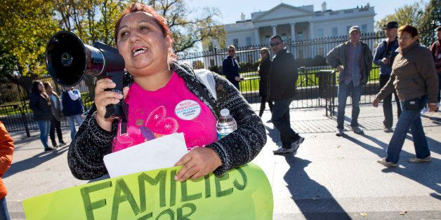 Ingrid Vaca, originally of Bolivia who now lives in Arlington, Va., rallies for immigration reform after marching from Arling