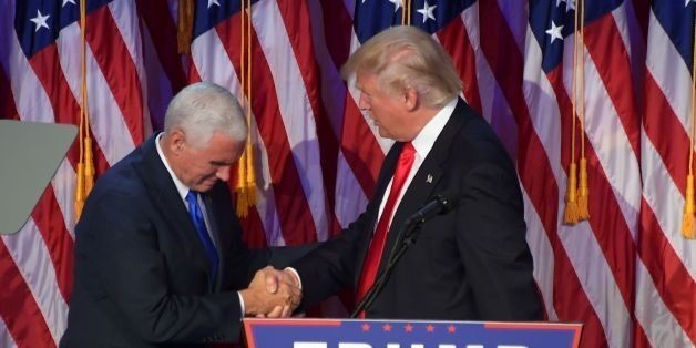 Republican presidential elect Donald Trump (R) shakes hands with Republican candidate for Vice President Mike Pence speak dur
