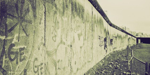 Retro sepia The Berlin Wall (Berliner Mauer) in Germany