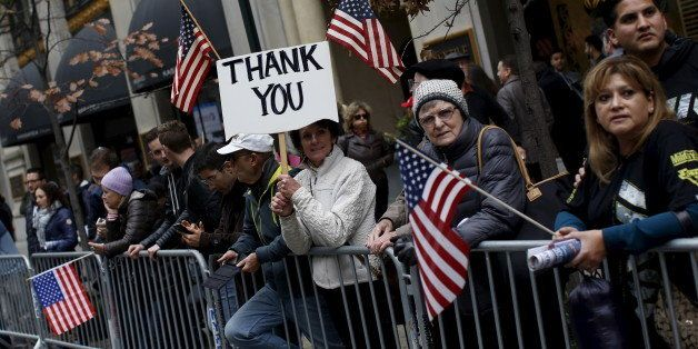 People watch as the Veterans' Day parade makes its way up 5th Avenue in New York November 11, 2015. REUTERS/Shannon Stapleton