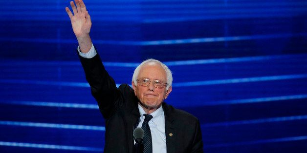 Former Democratic presidential candidate, Sen. Bernie Sanders, I-Vt., waves to the delegates before addressing the first day