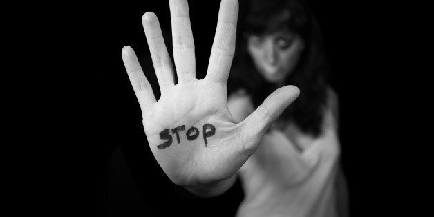 Stop violence against women. Hand saying stop
