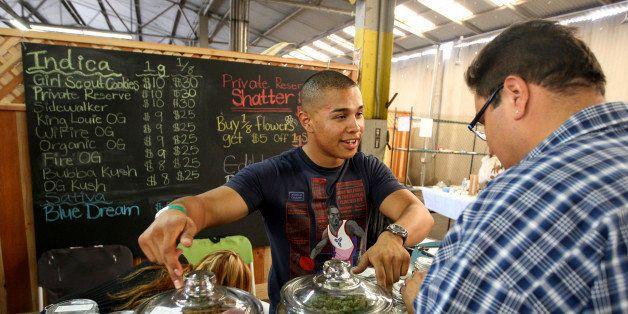 Grower Anthony Nguyen sells marijuana at the medical marijuana farmers market at the California Heritage Market in Los Angele