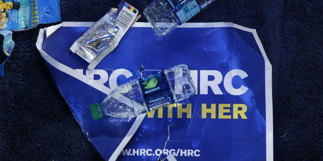 A campaign sign sits covered in trash after an election night party for 2016 Democratic Presidential Candidate Hillary Clinto