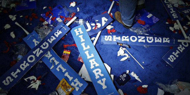 A worker walks past a 'Hillary' sign on the floor after the Democratic National Convention (DNC) in Philadelphia, Pennsylvani