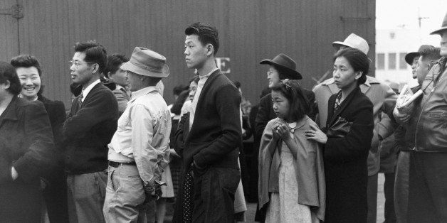 Japanese-Americans in Los Angeles, California, watching a train take their friends and relatives to the Owens Valley internme