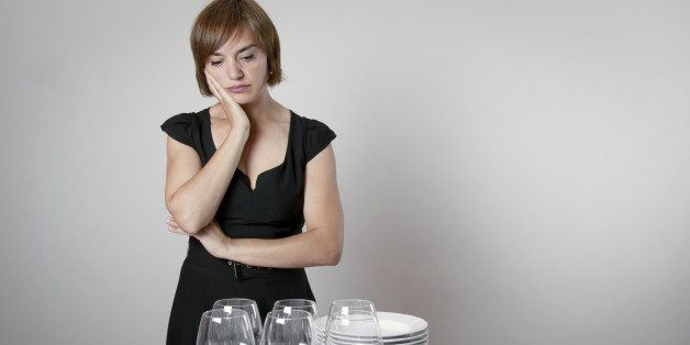 Worried woman setting the table for a celebration day
