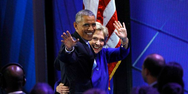 U.S. President Barack Obama and Democratic Nominee for President Hillary Clinton leave the stage at the Democratic National C