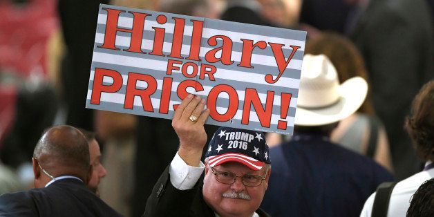 A Donald Trump supporter holds a sign on the floor of the Quicken Loans Arena before the start of the Republican National Con