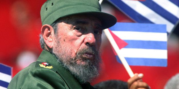 Then Cuban President Fidel Castro glances over his shoulder during the May Day commemoration at Revolution Square in Havana,