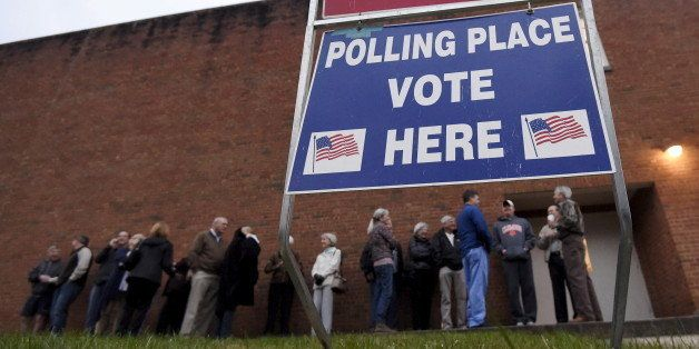 Voters wait in line at a polling station in Greenville, South Carolina, February 20, 2016. REUTERS/Rainier Ehrhardt