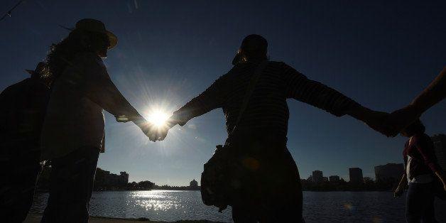 Protesters against President-elect Republican Donald Trump ring Lake Merritt's shoreline in Oakland, California, U.S. Novembe