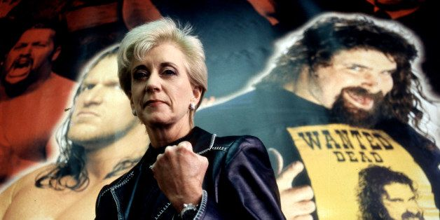 362424 05: Linda McMahon, President and CEO of the World Wrestling Federation poses for a portrait with the federation poster