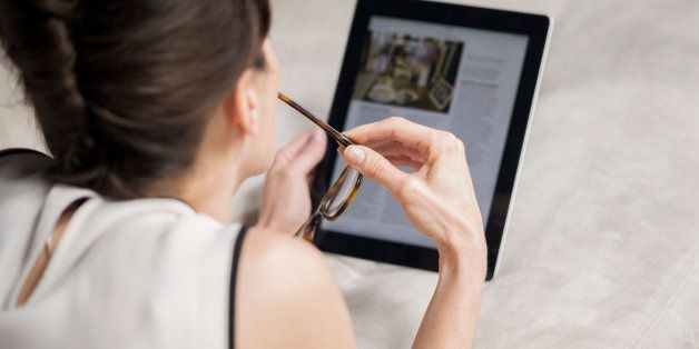 Woman looking at a digital tablet