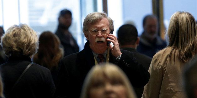 Former U.S. Ambassador to the United Nations John Bolton speaks on a mobile phone as he arrives for a meeting with U.S. Presi