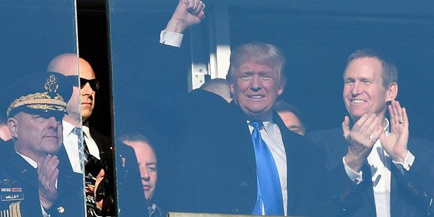 Dec 10, 2016; Baltimore, MD, USA;  United States of America president elect Donald Trump waves to the crowd from a suit durin