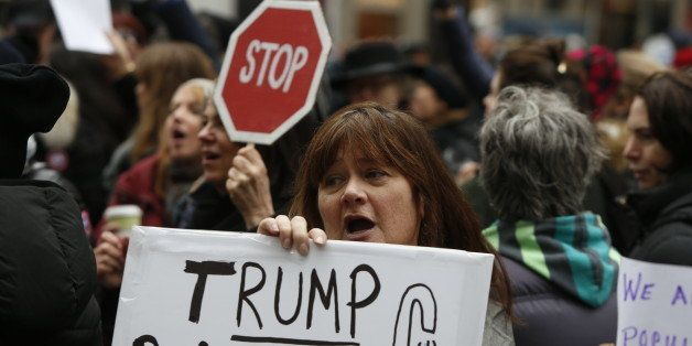 MANHATTAN, NEW YORK CITY, NEW YORK, UNITED STATES - 2016/12/12: Hundreds of activists, mostly women, gathered in front of Trump International in Columbus Circle for a 'Not My President!' rally and march against the inauguration of President-elect Donald Trump. After speeches from protesters that included playwright & activist Eve Ensler, activists marched across 59th Street to Trump Tower on 5th Avenue. (Photo by Andy Katz/Pacific Press/LightRocket via Getty Images)