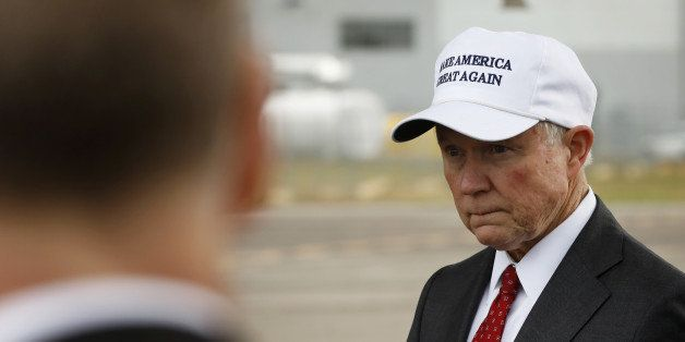 Senator Jeff Sessions (R-AL) waits for U.S. President-elect Donald Trump to exit his plane after arriving for stop on his USA