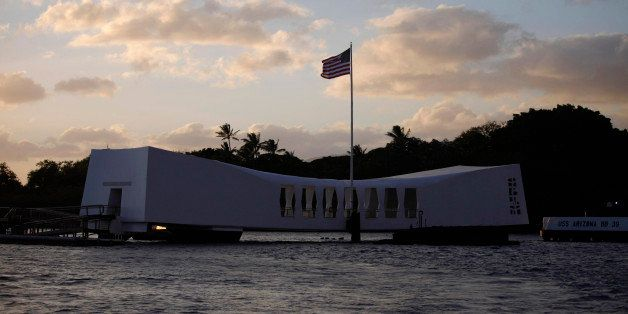 The USS Arizona Memorial is pictured at sunset in Pearl Harbor, Hawaii, December 29, 2011. U.S. President Barack Obama and fi