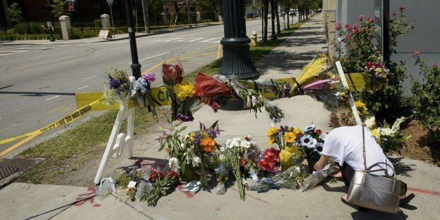 A woman places flowers at a makeshift memorial near the Emanuel AME Church June 18, 2015 in Charleston, South Carolina, after