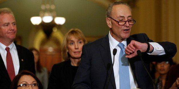 U.S. Senate Minority Leader Chuck Schumer (D-NY), flanked by freshman Democrats Senator Chris Van Hollen (D-MD) (L), Senator