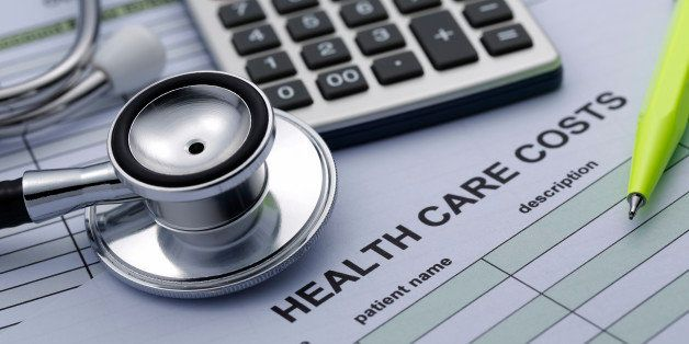 Health care Cost statistics with stethoscope and Calculator