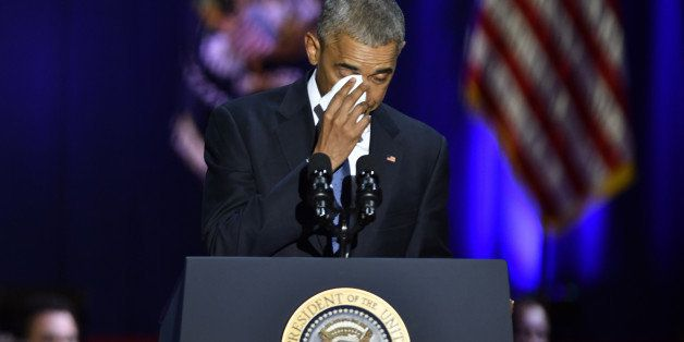 U.S. President Barack Obama wipes his tears while speaking about U.S. First Lady Michelle Obama, not pictured, during his far
