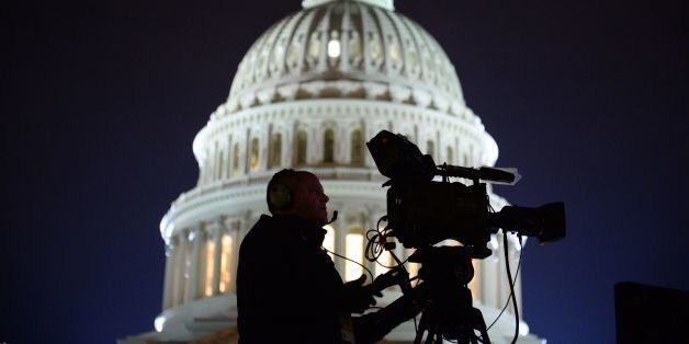 The US Capitol Building is pictured as media gather on January 20, 2017 in Washington, DC.  Donald Trump will be sworn in as