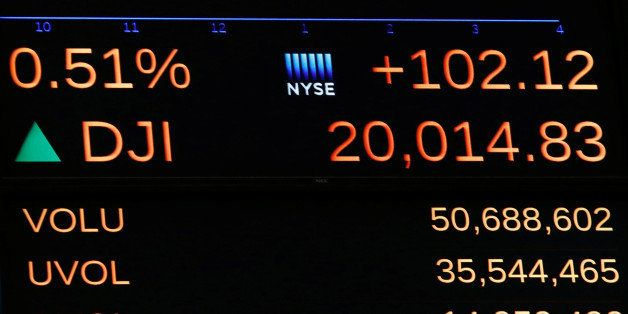 A display on the main trading floor of the New York Stock Exchange (NYSE) shows the Dow Jones Industrial Average over the 20,
