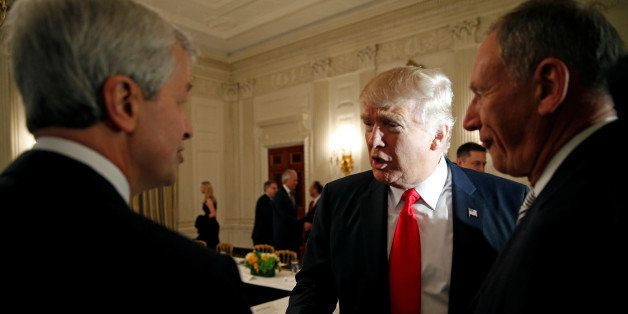 U.S. President Donald Trump shakes hands with JPMorgan Chase & Co CEO Jamie Dimon (L) as he hosts a strategy and policy forum