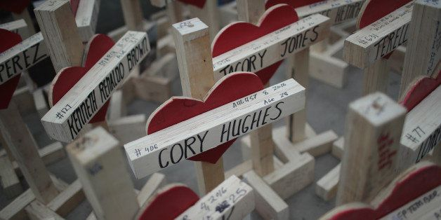 CHICAGO, IL - DECEMBER 31:  Nearly 800 crosses, each bearing the name of a murder victim, sit on the sidewalk along Michigan
