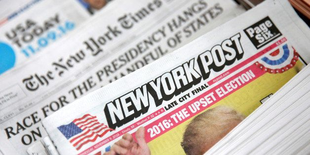 The cover of the New York Post newspaper is seen with other papers at a newsstand in New York U.S., November 9, 2016. REUTERS