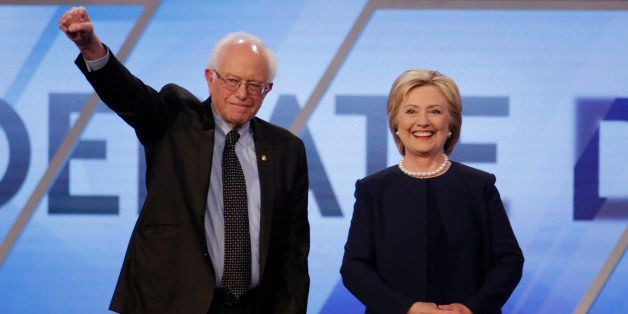 Democratic U.S. presidential candidates Senator Bernie Sanders and Hillary Clinton pose before the start of the Univision New