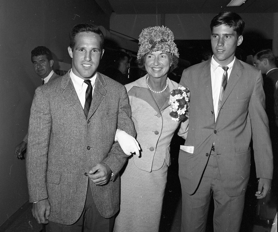 Mitt Romney, right with his mother and brother Scott, shortly after departing a plane at San Francisco International Airport.