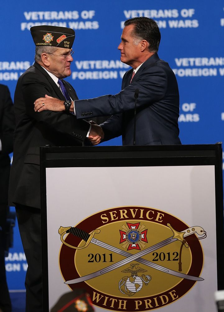 RENO, NV - JULY 24:  Republican presidential candidate and former Massachusetts Gov. Mitt Romney (R) greets Veterans of Forei