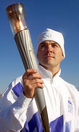 Description Picture of en:John Nowak  carrying the Olympic Torch to Salt Lake City and the 2002 Winter Games. Picture from: h