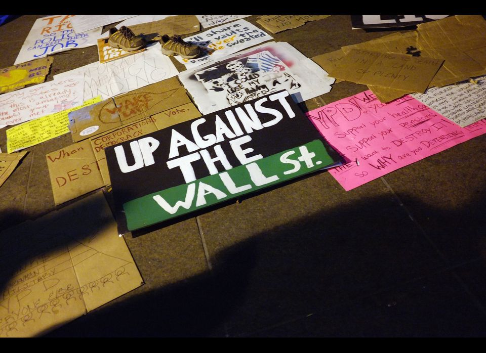 NEW YORK, NY - OCTOBER 11: Signs belonging to Occupy Wall Street protesters lie in Zuccotti Park where hundreds of activists