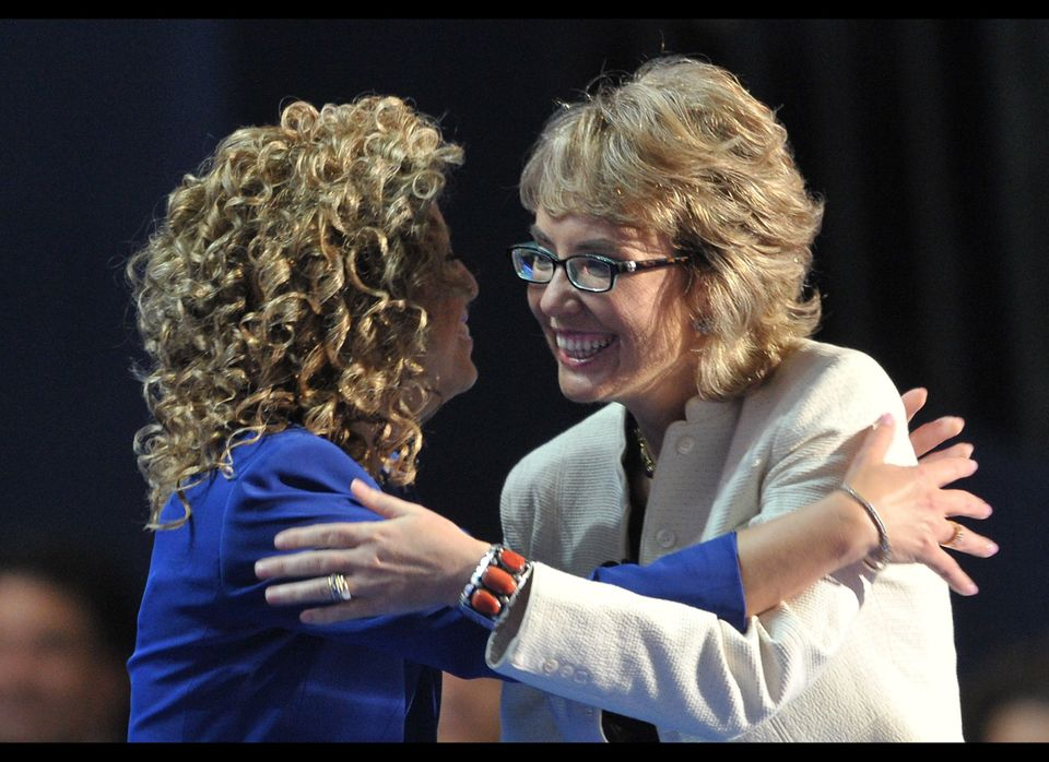 Chair of the Democratic National Committee Debbie Wasserman Schultz (L) and former congresswoman Gabrielle Giffords embrace a